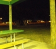 Sunrise Park Playground At Night With Children From NA Meeting Playing In The Dark